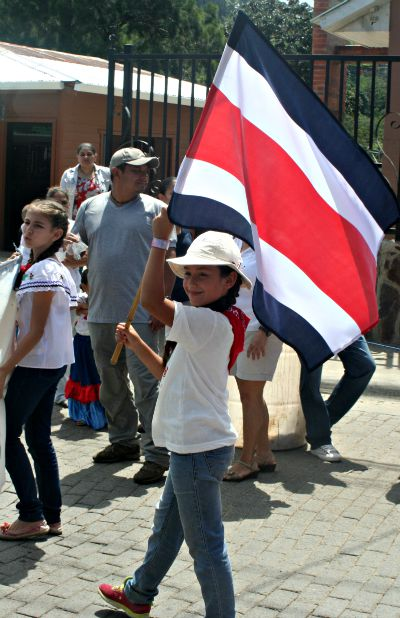 Nationalism in action: MFS student waves Costa Rican flag at Independence Day parade